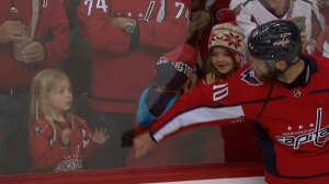 Washington Capitals forward Brett Connolly has drawn praise on social media for insisting that a little girl receive a warm-up puck at a recent playoff game. (NBC Sports)