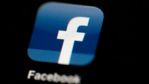 In this May 16, 2012, file photo, the Facebook logo is displayed on an iPad in Philadelphia. (AP Photo/Matt Rourke, File)