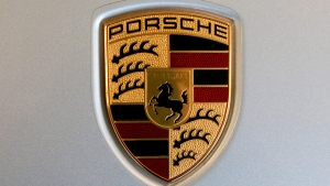 The Feb. 15, 2018 file photo shows a Porsche logo on a 2018 718 Cayman automobile on display at the Pittsburgh Auto Show.  (AP Photo/Gene J. Puskar, file)