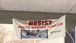 Demonstrators unfurled a massive anti-pipeline banner at the Vancouver courthouses on April 18, 2018. It hung for about an hour before police told them to take it down.