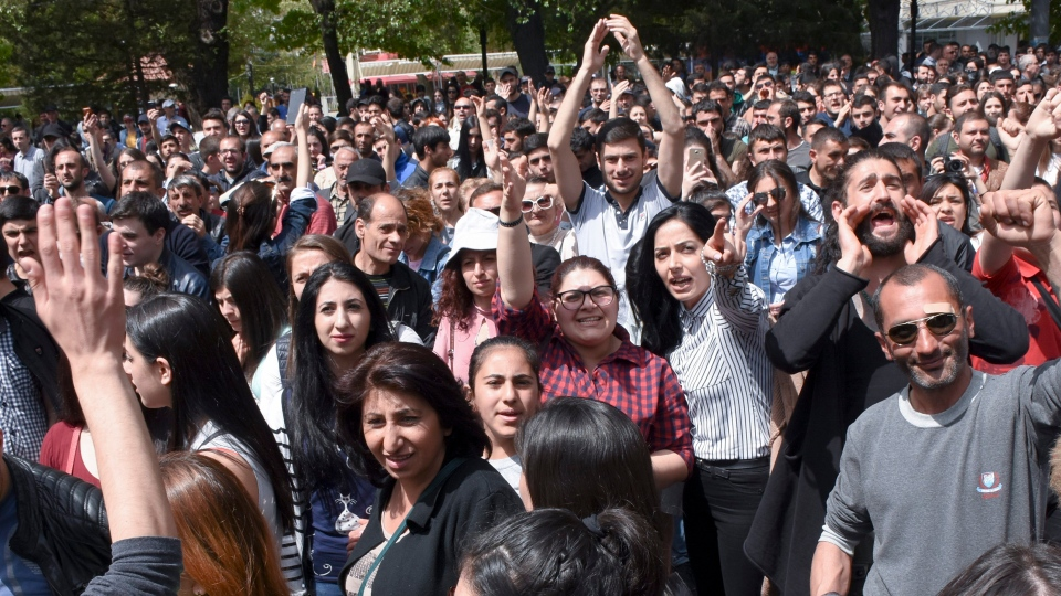 Opposition demonstrators march to protest the former president's shift into the prime minister's seat in Yerevan, Armenia, Wednesday, April 18, 2018. (Narek Aleksanyan, PAN Photo via AP)