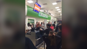 In this image taken by a Sunwing passenger in the early hours of Tuesday, April 17, 2018, an airline representative informs frustrated travellers that they won't be headed home that night. (Source: Shelby Zhng)