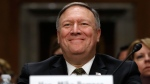 Secretary of State-designate Mike Pompeo smiles after his introduction before the Senate Foreign Relations Committee during a confirmation on Capitol Hill in Washington on Thursday, April 12, 2018. (AP Photo/Jacquelyn Martin)