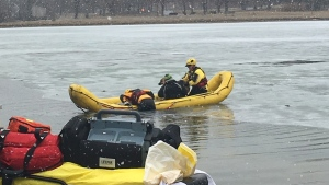 The Ottawa Fire Water Rescue Team person form an ice rescue at Andrew Haydon Park Tuesday.