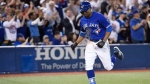 Toronto Blue Jays designated hitter Curtis Granderson (18) rounds the bases after hitting a grand slam off of Kansas City Royals relief pitcher Justin Grimm during eighth inning AL baseball action in Toronto on Wednesday, April 18, 2018. (THE CANADIAN PRESS/Nathan Denette)