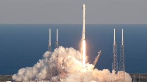 A SpaceX Falcon 9 rocket transporting the TESS satellite lifts off from launch complex 40 at the Cape Canaveral Air Force Station in Cape Canaveral, Fla., Wednesday, April 18, 2018. (AP Photo/John Raoux)