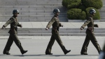 North Korean soldiers march at the border village of Panmunjom in the Demilitarized Zone, South Korea on Wednesday, April 18, 2018. (AP Photo/Lee Jin-man)