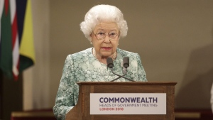 Queen Elizabeth II speaks during the formal opening of the Commonwealth Heads of Government Meeting in the ballroom at Buckingham Palace in London, on April 19, 2018. (Yui Mok/Pool via AP)
