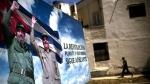 A poster of Fidel Castro and Cuba's President Raul Castro stands in Havana, Cuba, on April 18, 2018. (Ramon Espinosa / AP)