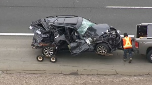 A totaled passenger vehicle is towed away from the scene of a crash on Highway 401 near Winston Churchill on April 19, 2018.