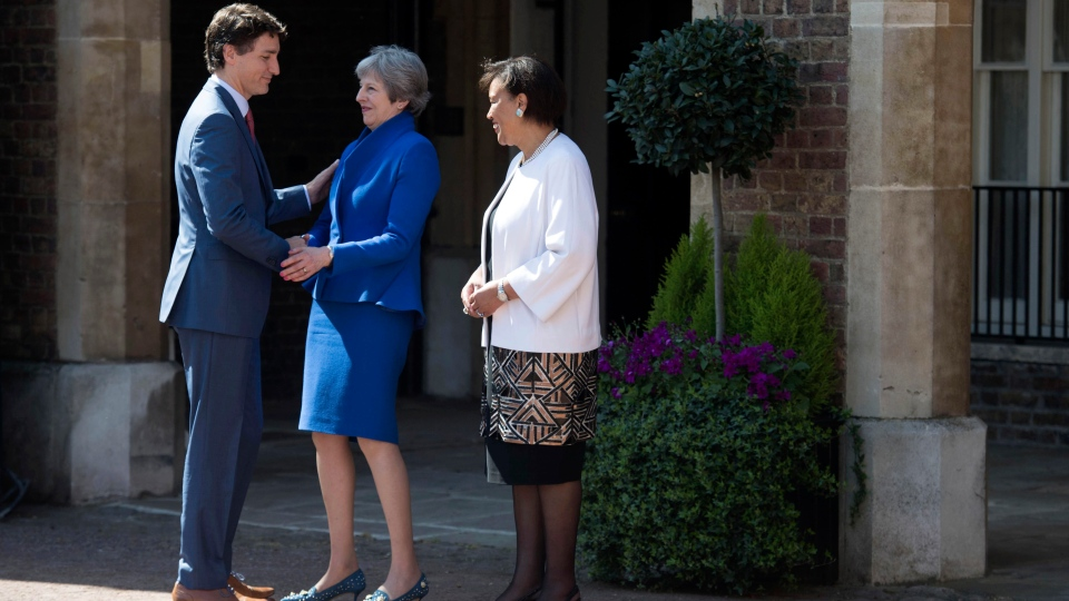Britain's Prime Minister Theresa May and Commonwealth Secretary-General Patricia Scotland, right, greet Canadian Prime Minister Justin Trudeau at the official welcome ceremony for the Commonwealth Heads of Government Meeting at Friary Court in St James's Palace, London, Thursday April 19, 2018. (Stefan Rousseau/PA via AP)