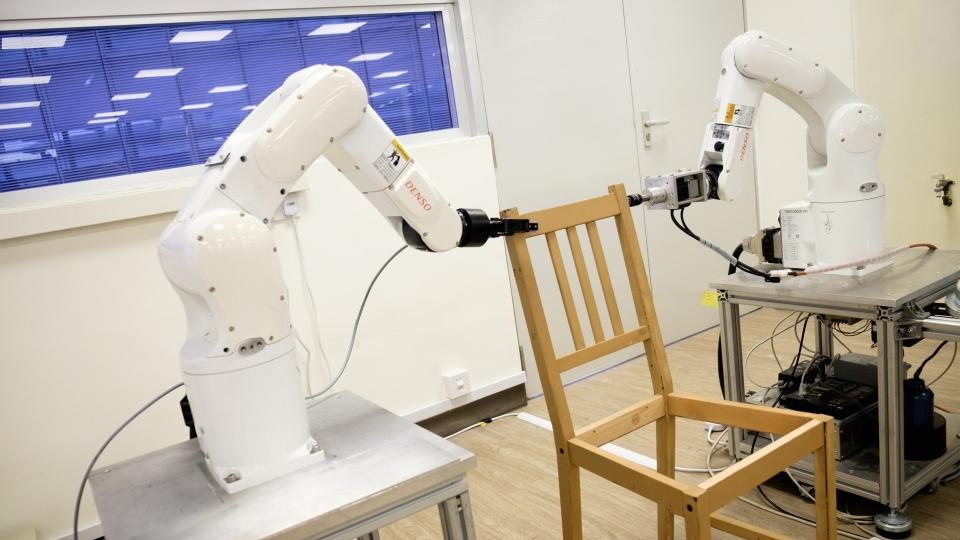 Autonomous robotic arms assembling an IKEA chair in Singapore. (Handout / NTU SINGAPORE / AFP)