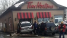 A van crashed into a Tim Hortons in Dalhousie, N.B. on April 18, 2018. (Mitch Thompson)