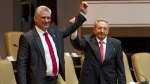 Cuba's new president Miguel Diaz-Canel, left, and former president Raul Castro, raise their arms after Diaz-Canel was elected as the island nation's new president, at the National Assembly in Havana, Cuba, Thursday, April 19, 2018. (Irene Perez/Cubadebate via AP)