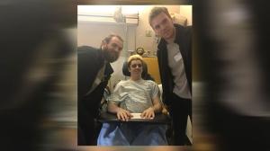 Ryan Straschnitzki poses alongside NHL stars Ryan O'Reilly and Connor McDavid in a Saskatoon hospital on April 17, 2018 (photo: Tom Straschnitzki)
