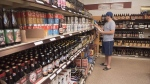 Customer Matt Oliver shops in the craft beer section of the NB Liquor store attached to the old Fredericton Railway Station in Fredericton, N.B., on Friday, June 16, 2017. (THE CANADIAN PRESS/Stephen MacGillivray)
