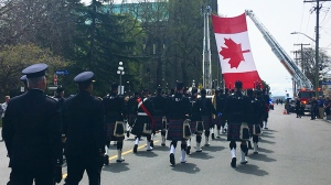 A procession marched down Quadra Street before a funeral was held at Victoria's Christ Church Cathedral for Const. Ian Jordan. April 19, 2018. (CTV Vancouver Island)