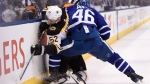 Boston Bruins centre Sean Kuraly (52) and Toronto Maple Leafs defenceman Roman Polak (46) battle along the boards during first period NHL round one playoff hockey action in Toronto on Thursday, April 19, 2018. (THE CANADIAN PRESS/Nathan Denette)