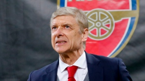 FILE - In this Thursday, March 8, 2018 file photo Arsenal's manager Arsene Wenger waits for the kick-off of the Europa League, round of 16 first-leg soccer match between AC Milan and Arsenal, at the Milan San Siro stadium, Italy. (AP Photo/Antonio Calanni, File)