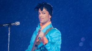 In this Feb. 4, 2007 file photo, Prince performs during the halftime show at the Super Bowl XLI football game at Dolphin Stadium in Miami. (AP Photo/David J. Phillip)