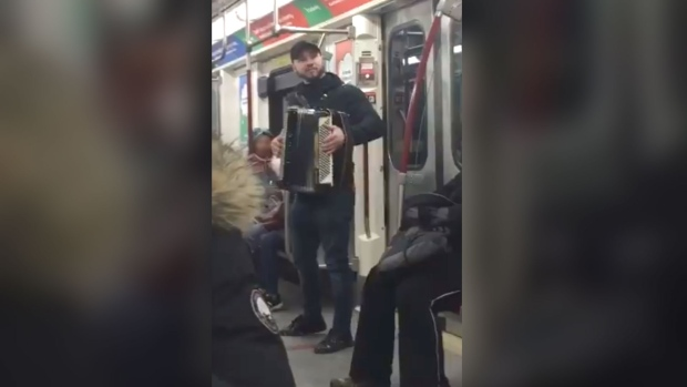 Busker on subway car