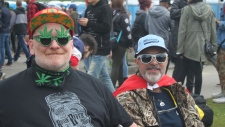 Shawno Ashmore, right, and husband Hugh, left, pose for a photo together at Vancouver's annual pro-pot rally on April 20, 2018.