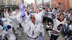 Winnipeg Jets' fans go crazy at a street party during NHL playoff game 5 action between the Winnipeg Jets and the Minnesota Wild in Winnipeg on Friday, April 20, 2018. THE CANADIAN PRESS/John Woods