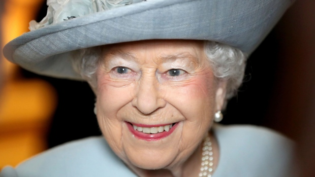 In this Feb. 20, 2018 file photo, Britain's Queen Elizabeth II smiles during a visit to the Royal College of Physicians, in London. (Chris Jackson/PA via AP, File)