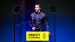 Former NFL quarterback and social justice activist Colin Kaepernick speeches after receiving the Amnesty International Ambassador of Conscience Award for 2018 in Amsterdam, Saturday April 21, 2018. (AP Photo/Peter Dejong)