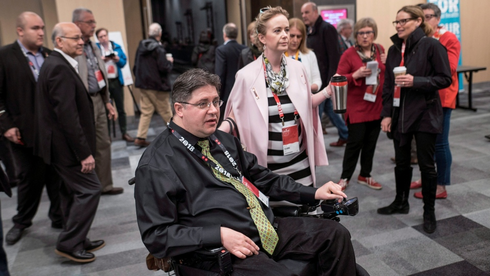 "Kent Hehr, left, MP for Calgary Centre, arrives with his wife Deanna Holt before attending a workshop titled ""Ensuring Safe Spaces and Ending Harassment"" during the federal Liberal national convention in Halifax on Saturday, April 21, 2018. THE CANADIAN PRESS/Darren Calabrese"