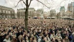 FILE - In this April 10, 2001 file photo, thousands demonstrate outside Dutch government buildings as the Upper House of Parliament debates the legalization of euthanasia at The Hague, Netherlands. (AP Photo/Serge Ligtenberg, File)