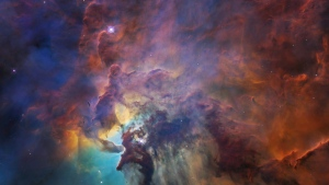 This February 2018 image made available by NASA on Thursday, April 19, 2018 shows the Lagoon Nebula, about 4,000 light-years away from the Earth, with the star Herschel 36 at center. The young star, 200,000 times brighter than our Sun, is blasting powerful ultraviolet radiation and hurricane-like stellar winds, carving out structures in the surrounding gas and dust. (NASA, ESA, STScI via AP)