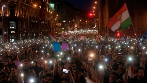 Thousands of people march during a protest in in Budapest, Hungary, Saturday, April 21, 2018. (Zsolt Szigetvary/MTI via AP)