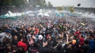 A cloud of smoke hangs over the crowd as thousands of people smoke marijuana during the 4-20 annual marijuana celebration, in Vancouver, B.C., on Friday April 20, 2018. (THE CANADIAN PRESS/Darryl Dyck)