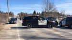 Police vehicles are seen on a bridge in Belwood,Ont., after a body was found in the Grand River on April 21, 2018. (Terry Kelly/ CTV Kitchener)