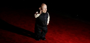"""This Oct. 6, 2009, file photo shows cast member Verne Troyer posing for photographs as he arrives at the gala premiere of the film """"The Imaginarium of Doctor Parnassus"""" at a cinema in London. Troyer from the """"Austin Powers"""" movie franchise has died. A statement provided by Troyer's representatives that was also posted to his Instagram and Facebook accounts says the 49-year-old actor died Saturday, April 21, 2018. No cause or place of death was given, but the statement discusses depression and suicide, and Troyer had publicly discussed struggling with alcohol addiction. He lived in Los Angeles. (AP Photo/Matt Dunham, File)"""