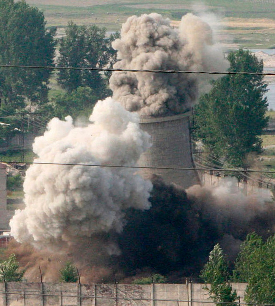 FILE - In this June 27, 2008 file photo released by China's Xinhua News Agency, the cooling tower of the Nyongbyon nuclear complex is demolished in Nyongbyon, also known as Yongbyon, North Korea.  (AP Photo/Xinhua, Gao Haorong, File)