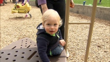 Michelle Rickinson's child plays at a Victoria-area park on April 20, 2018.