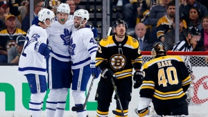 Toronto Maple Leafs' James van Riemsdyk (25) celebrates his goal against Boston Bruins' Tuukka Rask (40), of Finland, with teammates Tyler Bozak (42) and Nazem Kadri (43) during the second period of Game 5 of an NHL hockey first-round playoff series in Boston, Saturday, April 21, 2018. (AP Photo/Michael Dwyer)
