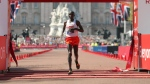 Kenya's Eliud Kipchoge crosses the finish line to win the Men's race in the London Marathon in central London, Sunday, April 22, 2018. (Paul Harding/PA via AP)