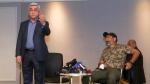 Former Armenian President Serzh Sargsyan, left, gestures as he leaves a meeting with protest leader Nikol Pashinian, right, in Yerevan, Armenia, Sunday, April 22, 2018. (Hrant Khachatryan/PAN Photo via AP)