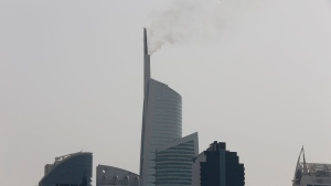 Smoke rises from the tip of the Almas Tower in Dubai's Jumeirah Lake Towers neighborhood, Sunday, April 22, 2018. (AP Photo/Kamran Jebreili)