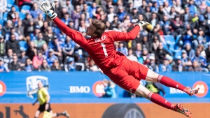 Los Angeles FC goalkeeper Tyler Miller deflects a shot as they face the Montreal Impact during second half MLS action Saturday, April 21, 2018 in Montreal. THE CANADIAN PRESS/Paul Chiasson
