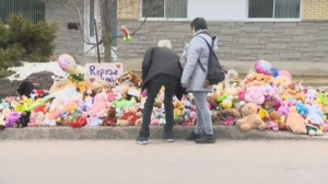 Mourners leave toys to commemorate Rosalie Gagnon in Quebec City.