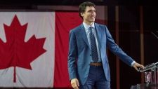 Prime Minister Justin Trudeau walks on stage before delivering a speech at the federal Liberal national convention in Halifax on Saturday, April 21, 2018. THE CANADIAN PRESS/Darren Calabrese