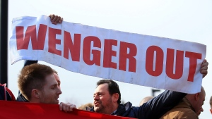 In this file photo, fans hold signs called for Arsenal manager Arsene Wenger to be sacked prior to the English Premier League soccer match between Arsenal and Norwich City, at the Emirates Stadium, in London, Saturday April 30, 2016. (John Walton/PA via AP)