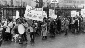About 1,500 people are seen marching through the heavy snowfall in support of International Women's Day in Toronto, Ont., March 8, 1980. Canadian security agents were so busy looking for Communist infiltrators in the flowering women's liberation movement, they all but missed a genuine social revolution that transformed millions of lives, says a newly published book. (THE CANADIAN PRESS/Jann Van Horne)