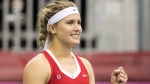 Eugenie Bouchard of Canada celebrates after defeating Lesia Tsurenko of Ukraine in their Fed Cup tennis match in Montreal, Sunday, April 22, 2018. (THE CANADIAN PRESS/Graham Hughes)