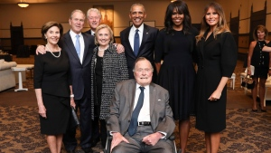 This Saturday, April 21, 2018, photo provided by the Office of former U.S. President George H.W. Bush, shows Bush, front center, and past presidents and first ladies Laura Bush, from left, George W. Bush, Bill Clinton, Hillary Clinton, Barack Obama, Michelle Obama and current first lady Melania Trump in a group photo at the funeral service for former first lady Barbara Bush, in Houston. (Paul Morse/Courtesy of Office of George H.W. Bush via AP)