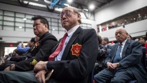 Members of the Chinese-Canadian community listen as Vancouver Mayor Gregor Robertson delivers an apology on behalf of the city for past discrimination against residents of Chinese descent, during a special city council meeting in Chinatown, in Vancouver, B.C., on Sunday April 22, 2018. (THE CANADIAN PRESS/Darryl Dyck)
